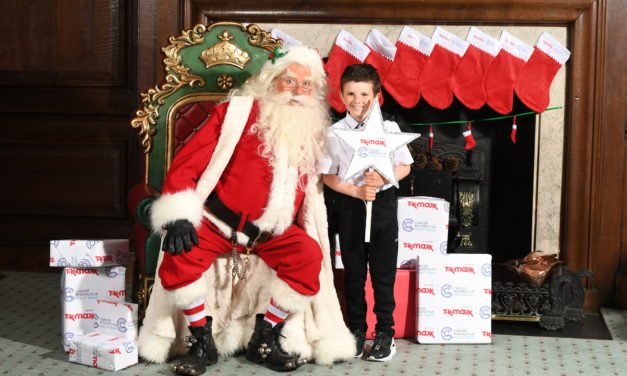 COURAGEOUS AUSTIN SHINES WITH SANTA AT STAR AWARDS PARTY