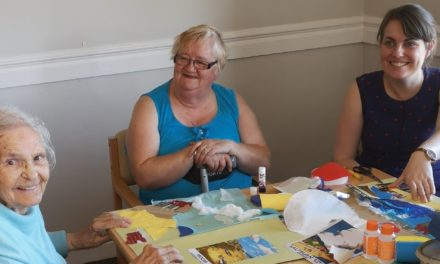 Art volunteers get elderly painting their windows