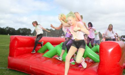 Charity fundraisers tackle a rainbow of obstacles in first colour run