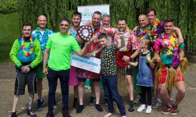 Daisy Chain dads hula their way to Boat Race triumph