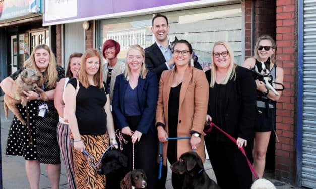 Redcar solicitors and playful pups raise significant funds for women's aid charity