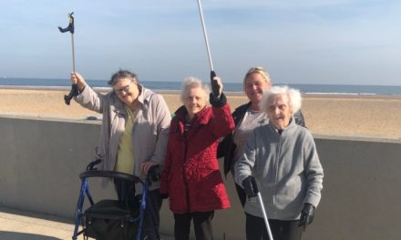 Elderly armed with litter pickers for beach clean up campaign
