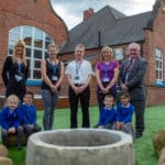 Companies join forces to create 'teaching garden' for school