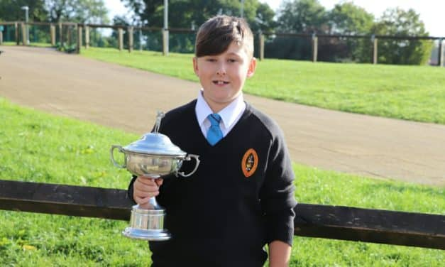 Young golfer swings to success