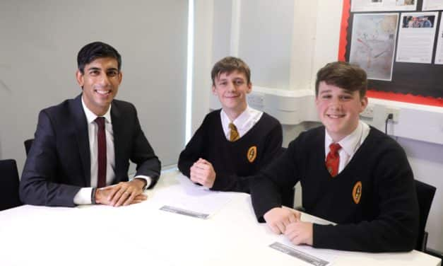 Students pose challenging questions to Government Minister