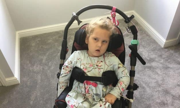Flooring store makes donation to appeal for severely disabled girl
