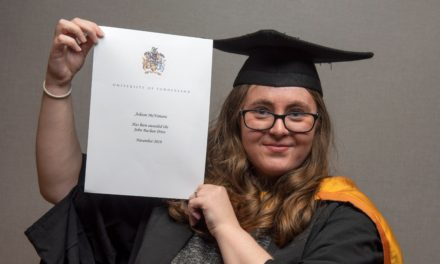 Graduate's late father inspires double prize
