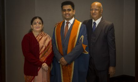 Family reunion as parents fly 4,500 miles in first trip abroad to see son graduate