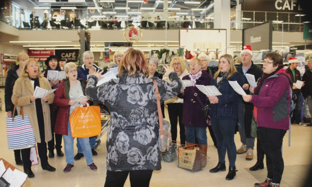Customers entertained by surprise singalong as they shopped
