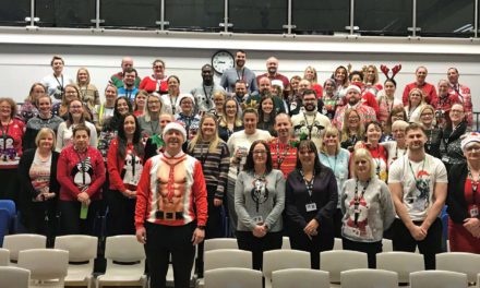 Staff swap suits for jolly jumpers in aid of charity