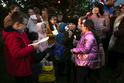 Beyond Housing hands out the goodies at community carol event