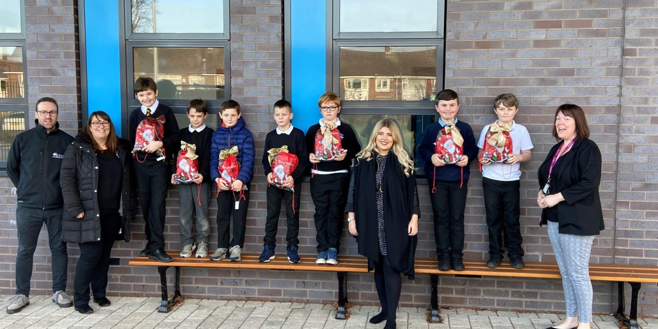 Company donates gift parcels worth over £3,000 to local school