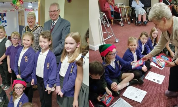 Carol singing primary school pupils perform at care home