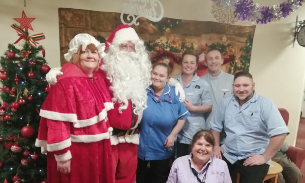 Santa Claus deliver early present to care home residents