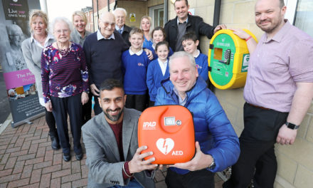 Community welcomes life saving defibrillator