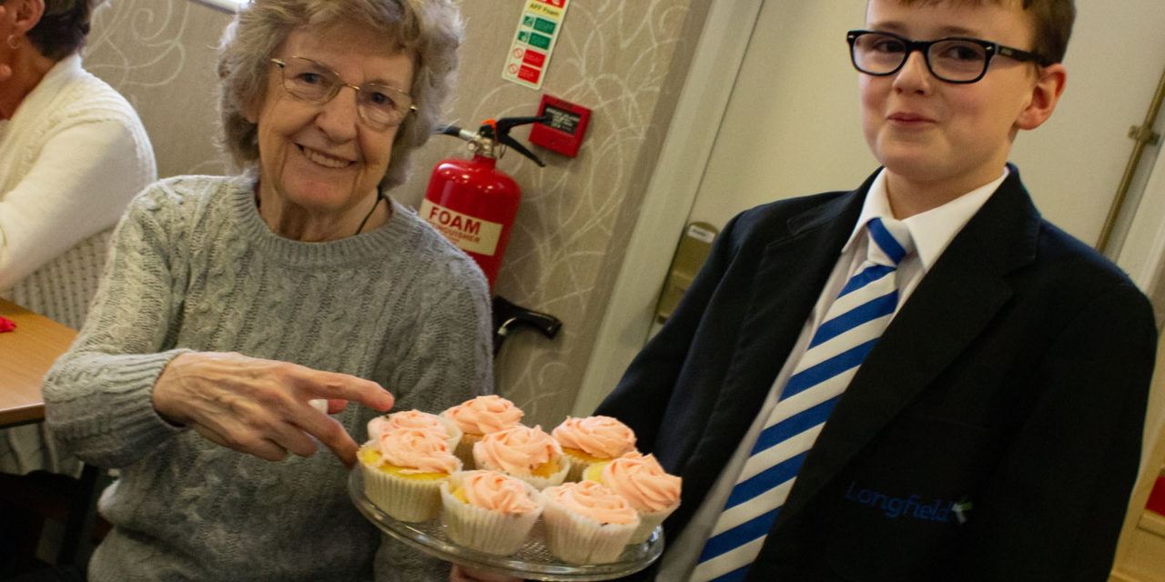 Baking pupils rise to the occasion in aid of the elderly