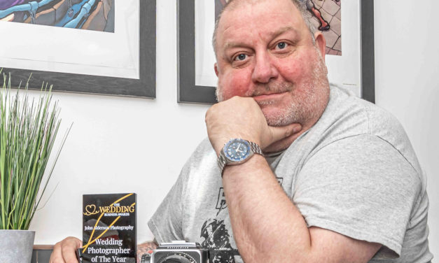 Photography tutor snaps up top industry award