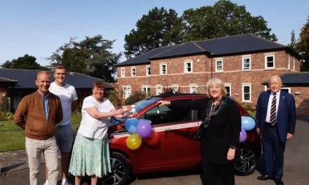 Charity supporter's dedication pays off as she wins a car