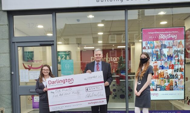 Christmas joy as building society gifts nearly £30,000 to good causes