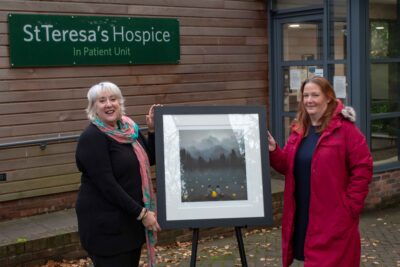 Gemma Guppy (right) from Arthaus gallery presents the print to St Teresa's Hospice chief executive Jane Bradshaw