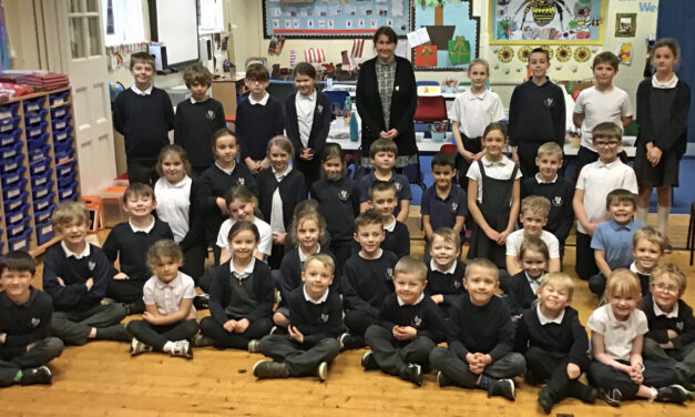 Retiring head teacher honoured at the double