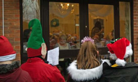 Children bring festive cheer to care home residents