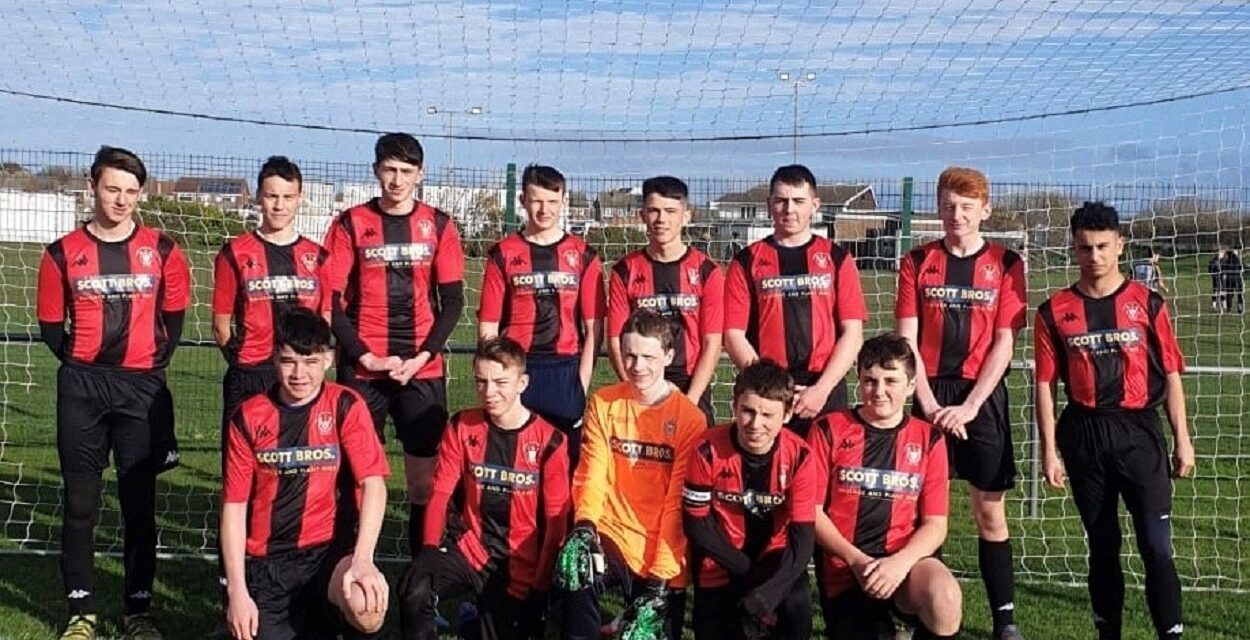 Junior footballers score new shirts thanks to Scott Bros' sponsorship
