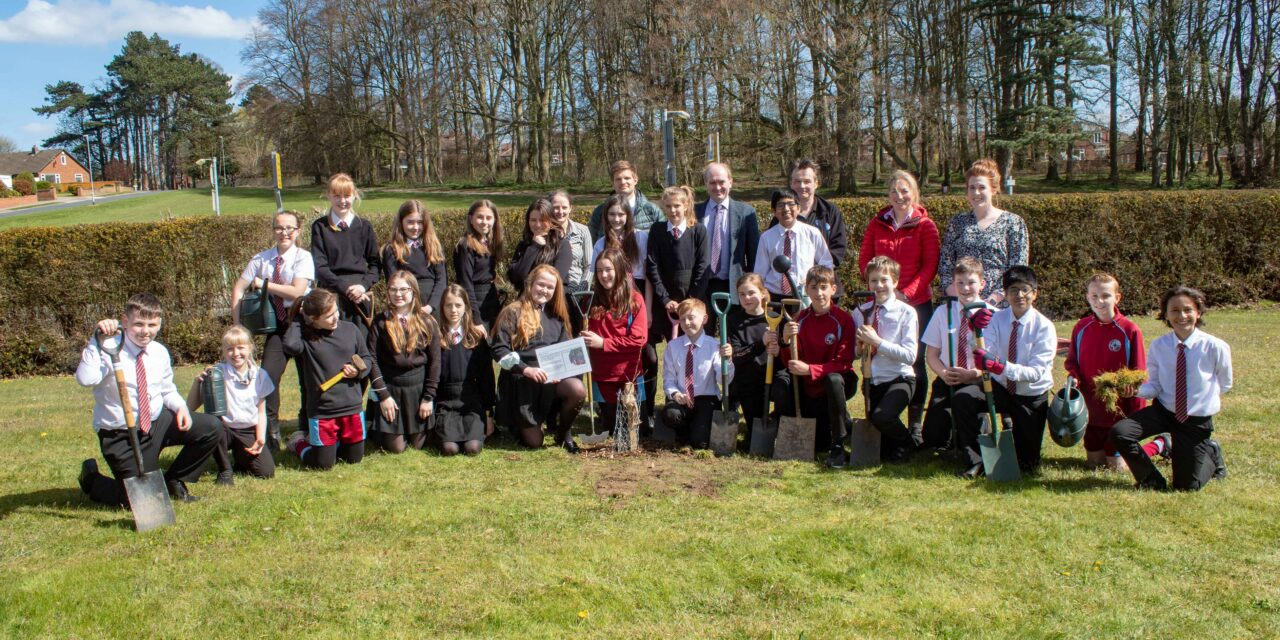 Pupils dig outside education as they plant trees for Earth Day