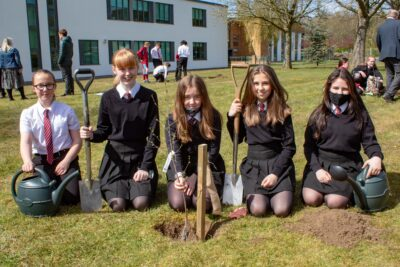 Lana Williams, Jessica Spink, Holly Ashford, Rosie Pilling, and Autumn Barras planted a silver birch sapling