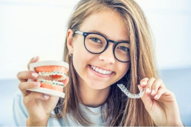 Invisible Aligners VS Braces: What Are The Pros And Cons?
