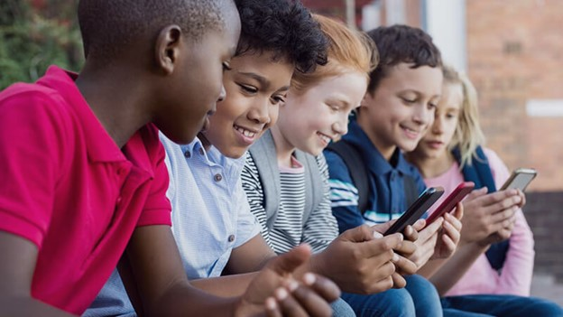 Children in the UK are using 4 screens at once and it's alarming!