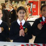 Services Students create stunning artwork with 100 poppies for Service to Remember